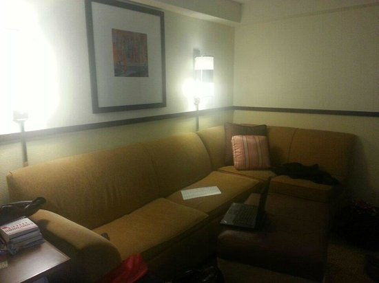 Hyatt Place Charlotte Airport/Tyvola Road: big L-shaped couch and ottoman in suite