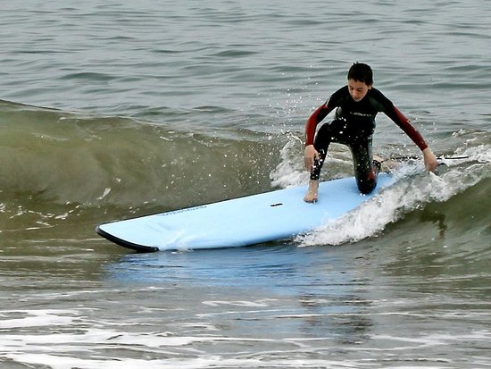 """Cal Coast Adventures: Max (14) success during 1st lesson.  """"TERRIFIC!  Never thought I'd be able to surf. I DID IT!"""""""