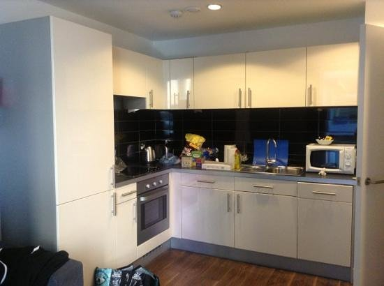 The Heart Apartments - MediaCityUK: tiny kitchen on one bedroom apartment, nothing like the photos