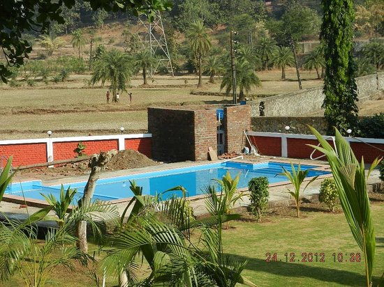 Hotel swimming pool area picture of green valley resort - Hotels in silvassa with swimming pool ...