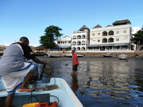 Lamu Palace Hotel from the water (Main building with awning)