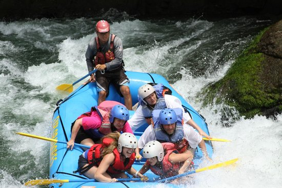 Exploradores Outdoors: Going over a rapid (that's me in the front looking old)