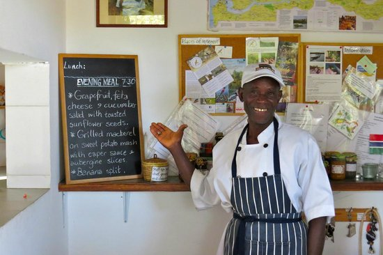 Farakunku Lodges: chief Lamin proudly showing the menu for tonight