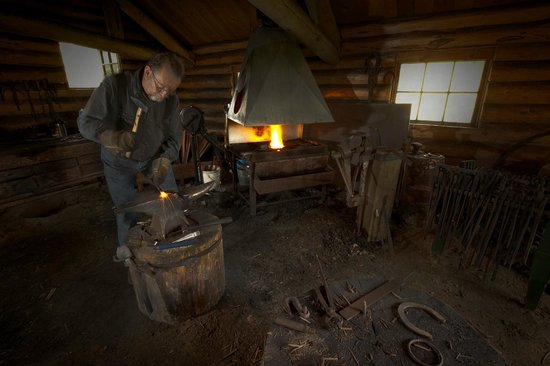 Huble Homestead Historic Site: The blacksmith hard at work in his shop.