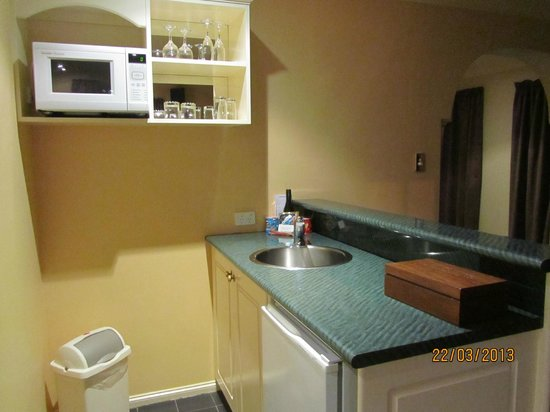 Country Club Villas: Kitchen area with all utilities. It also has a portable electric cooktop