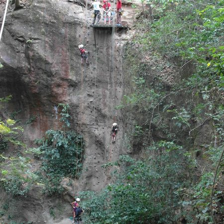 Hacienda Guachipelin: Climbing the cliff during zipline tour
