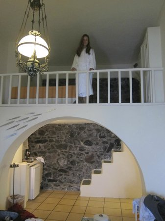 Enigma Apartments & Suites: I am standing right at the foot of the bed - yikes!
