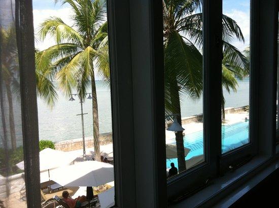 Eastern & Oriental Hotel: Sea-view suite overlooking the pool