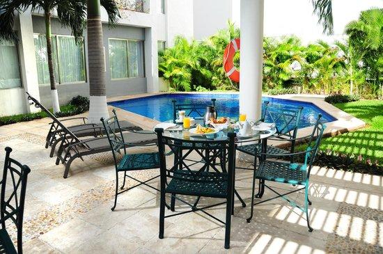 Ambiance Suites: Disfrute nuestra alberca