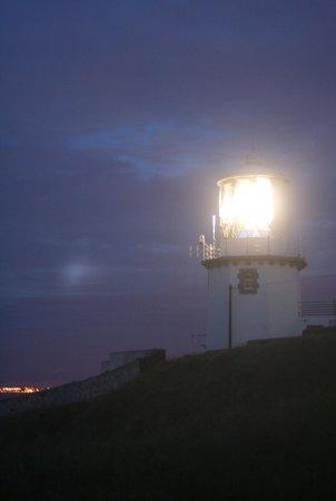 Blackhead Lightkeepers' Houses: A glorious sight at night; Bangor coast behind.