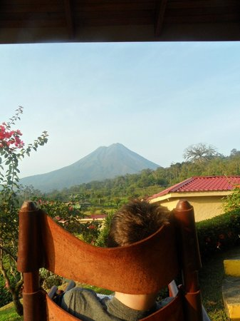 Arenal Volcano Inn: rocking chair on the front porch of the room, view of Arenal