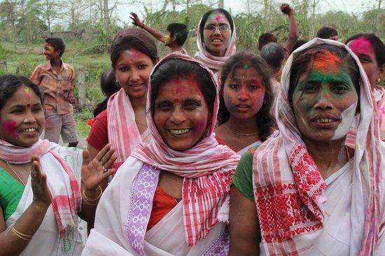 Brahmaputra River: Holi festival, Assamese riverside village