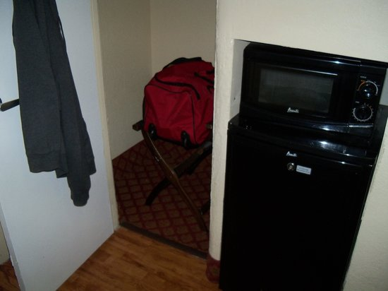 Americas Best Value Inn: closet, microwave, fridge