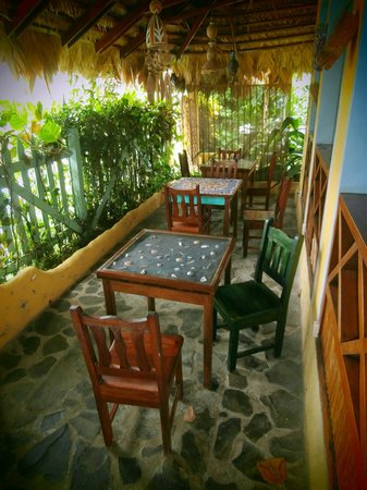 Hotel Guarana : Dining tables out front