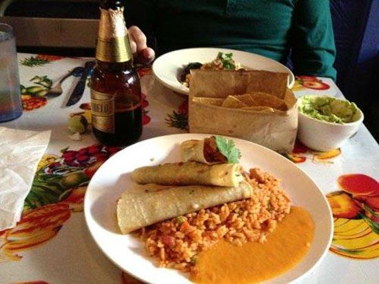 Mexicana Mama: Fish tacos, rice, habanero sauce, guacamole & chips