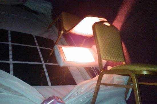 Dragonfly Hotel King's Lynn : Chairs used to guard because children were running past the heaters.