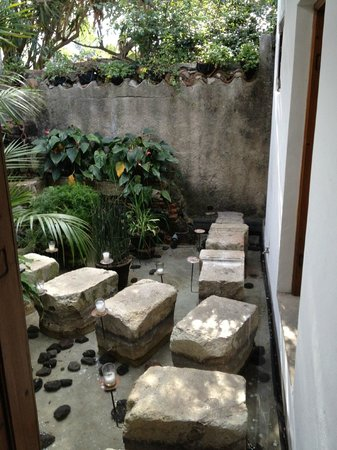 Casa Encantada: View looking out my door showing stepping stones to lobby