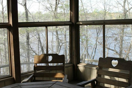 Killens Pond Campground: porch with a pond view in Cabin #11