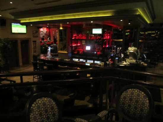 Harrys on the Green: The bar is located in the center of the downstairs pub