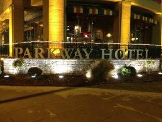 The Parkway Hotel: Hotel sign lit up at night.