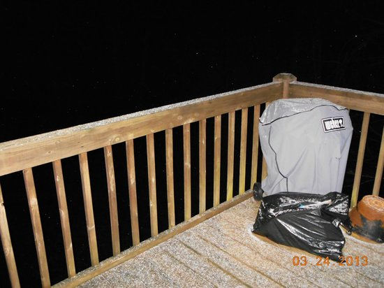 Mountain Top Cabin Rentals: snow on the porch and charcoal grill