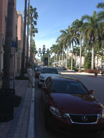 Mizner Park: An assortment of cars to be seen there, random kid posing