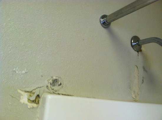 Aladdin Inn and Suites : Hard to see ALL the water damage in the wall with this photo.  This is from the shower.