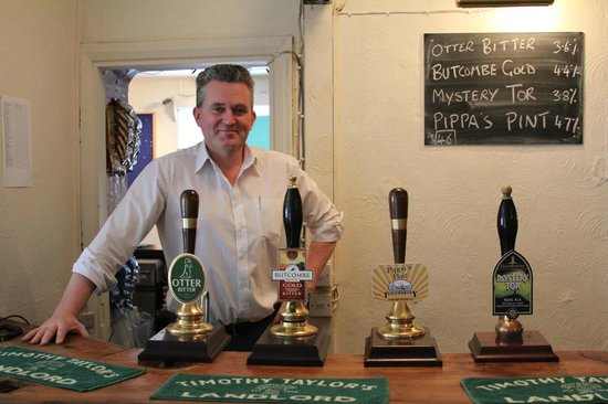 Rose and Portcullis: The Landlord behind the bar