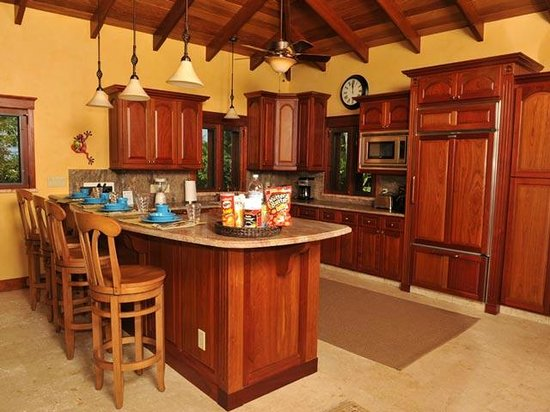 Coral Oasis Villa: The kitchen features granite countertops, and a farmhouse sink with copper fixtures
