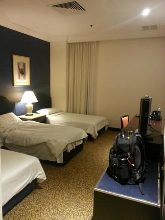 Ambassador Transit Hotel Terminal 1: THis room had 3 twin  beds. Others are available. (photo taken in morning sheets were fresh when