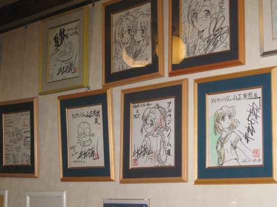 Yamasho Ryokan: Artwork from anime posted in dining room.