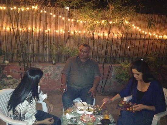 Tej Abode: WIth guests having dinner at the Patio