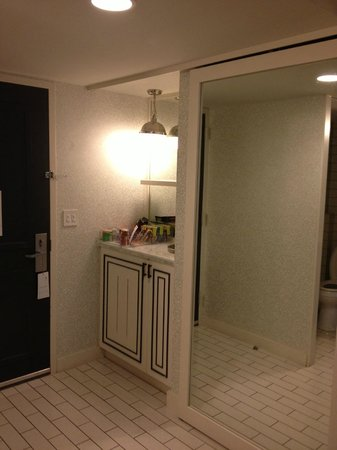 W Atlanta - Buckhead: closet and cabinet that hid the safe and fridge