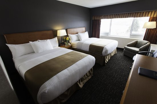 Rediscover the Park Town Hotel in one of our Double Queen Rooms