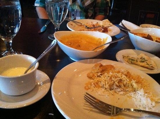 Mint Cuisine of India: Fresh naan, coconut soup, coconut curry chicken, and lamb.