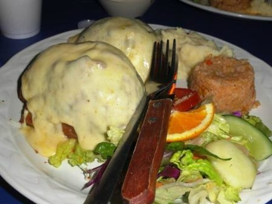 Mariscos el Toro Guero: Breaded filet stuffed with shrimp, octopus and scallops with cheese sauce