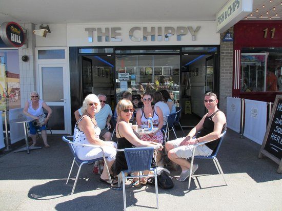 In the sun outside the Chippy