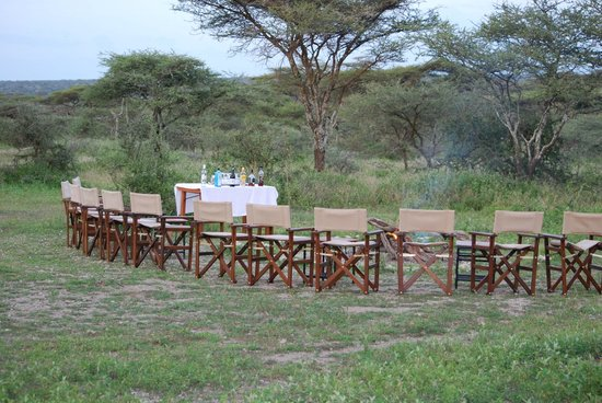 Ndutu Wilderness Camp: Fire pit appetizer/drinks area