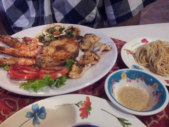 Hoang Vu: Small grilled seafood dish with garlic noodles