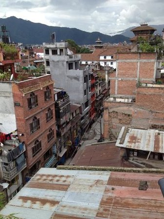 Monumental Paradise Guesthouse: roof top view. Durbar Sq palaces at the end
