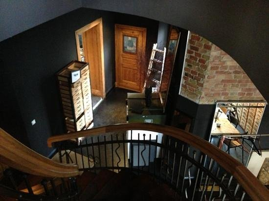 Linnen: stairs down from bedrooms to the cafe