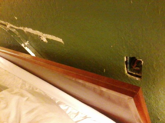 MainStay Suites : Headboard pulled from wall and hole in wall