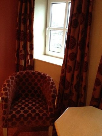 Newgrange Hotel: modern style chair and curtains
