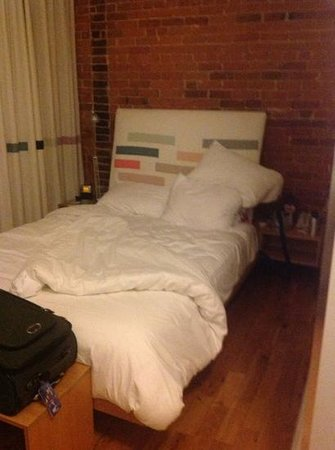 "Gladstone Hotel: The double bed in ""Refresh"", Room 312."