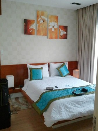 Angela Boutique Serviced Residence : coin chambre