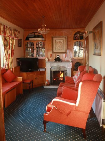 Riverside House: guest lounge on a cold sping evening with a roaring fire