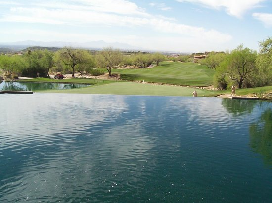 Flying-V Bar & Grill: A view of the golf course above the waterfall which you see from terrace seating at the Flying V