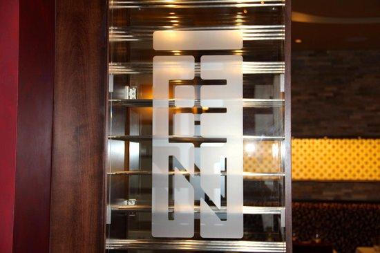 TEN's logo on a wine rack