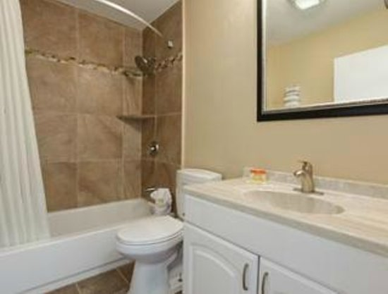 Hotel bathroom picture of days inn suites san diego for Bathroom suites direct