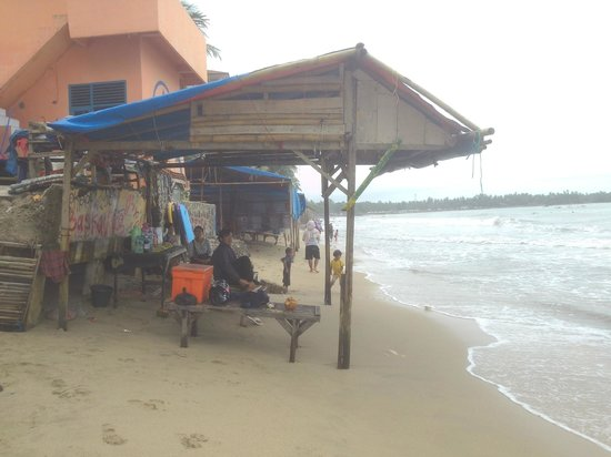 The Tirtha Arumdalu Hills: interesting to see a shop flooded by waves, why do they built here?